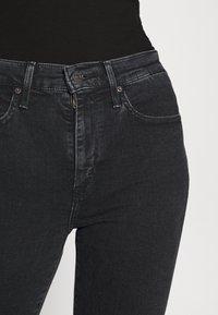 Levi's® - 724 HIRISE STRAIGHT CROP - Straight leg jeans - black denim - 5