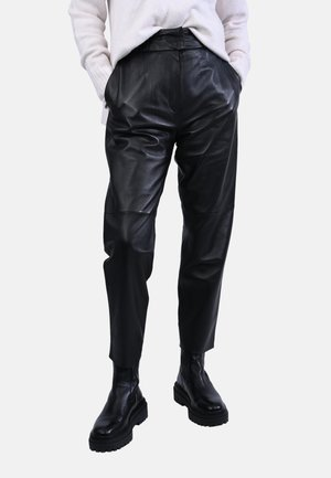 PALAMITA - Leather trousers - black