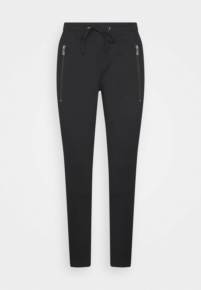 ZIPPED PANTS - Pantalones - deep black