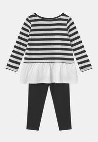 Levi's® - PEPLUM SET - Leggings - Trousers - black - 1