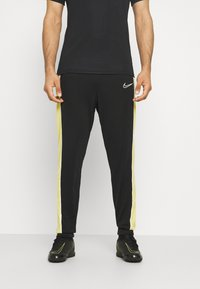 Nike Performance - ACADEMY PANT - Teplákové kalhoty - black/saturn gold/white - 0