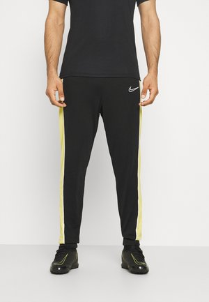 ACADEMY PANT - Tracksuit bottoms - black/saturn gold/white