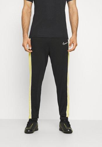 ACADEMY PANT - Pantaloni sportivi - black/saturn gold/white