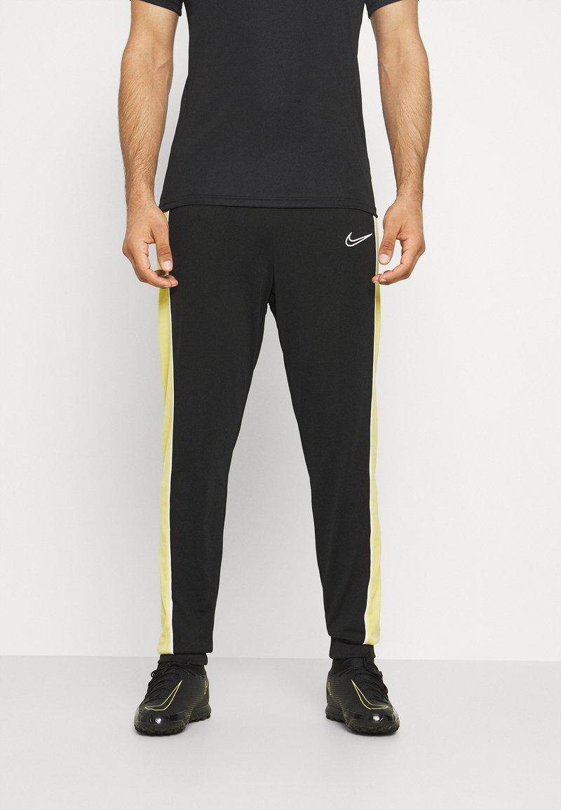 Nike Performance - ACADEMY PANT - Teplákové kalhoty - black/saturn gold/white