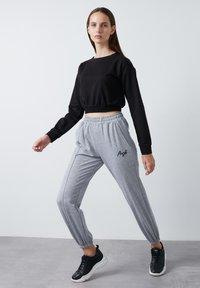 LELA - Tracksuit bottoms - grey - 0