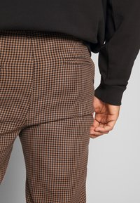 Nominal - KIRK TROUSER - Trousers - black
