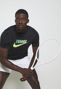 Nike Performance - GRAPHIC - Print T-shirt - black/volt/neo turq - 3