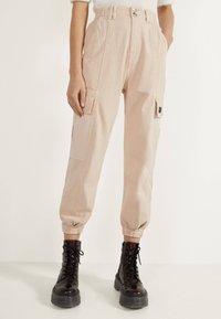 Bershka - Trousers - mottled beige - 0