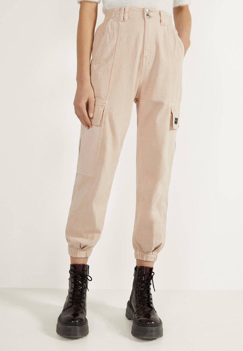 Bershka - Trousers - mottled beige