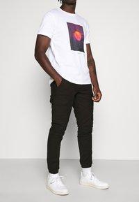 Topman - CARGO TROUSER - Cargo trousers - black - 0