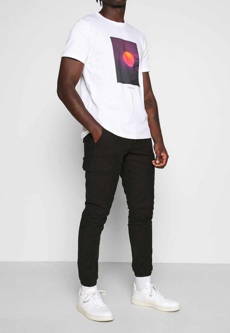 Topman - CARGO TROUSER - Cargo trousers - black