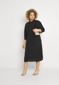 ONLY Carmakoma - CARNOVA LONG SHIRT DRESS SOLID - Shirt dress - black - 1