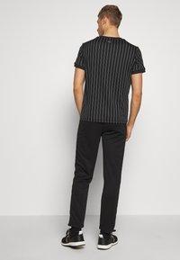 Fila - PANT PIUS - Pantaloni sportivi - black - 2