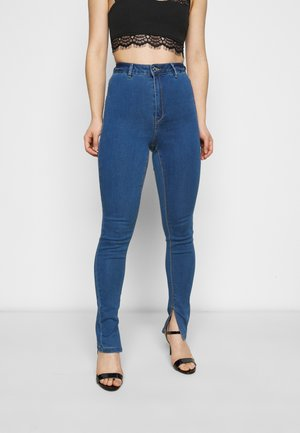 COATED SPLIT VICE - Trousers - blue
