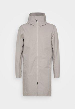 ONE PARKA - Hardshell jacket - sandstorm