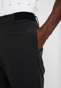 Puma Golf - STRETCH UTILITY PANT 2.0 - Trousers - black - 3