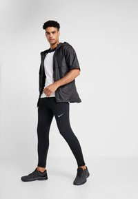 Nike Performance - ESSENTIAL PANT - Tracksuit bottoms - black/reflective silver - 1