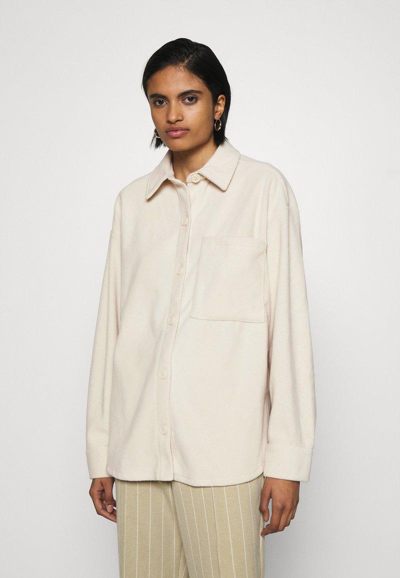Monki - DIDO - Button-down blouse - beige dusty light