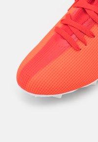 adidas Performance - X SPEEDFLOW.3 FG UNISEX - Kopačky lisovky - red/core black/solar red - 5