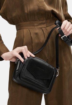 SARA ANIMATION S KLEINE - Across body bag - black