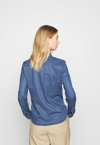ONLY - ONLROCKIT LIFE - Button-down blouse - medium blue denim - 3