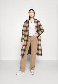 Monki - SANDRA BLOUSE - Button-down blouse - white - 1
