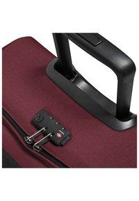 Eastpak - TRANVERZ  - Wheeled suitcase - red - 6