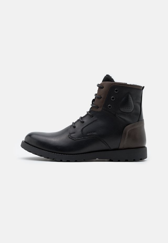 HIGHLAND - Lace-up ankle boots - black