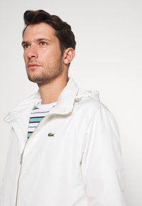 Lacoste - Summer jacket - flour