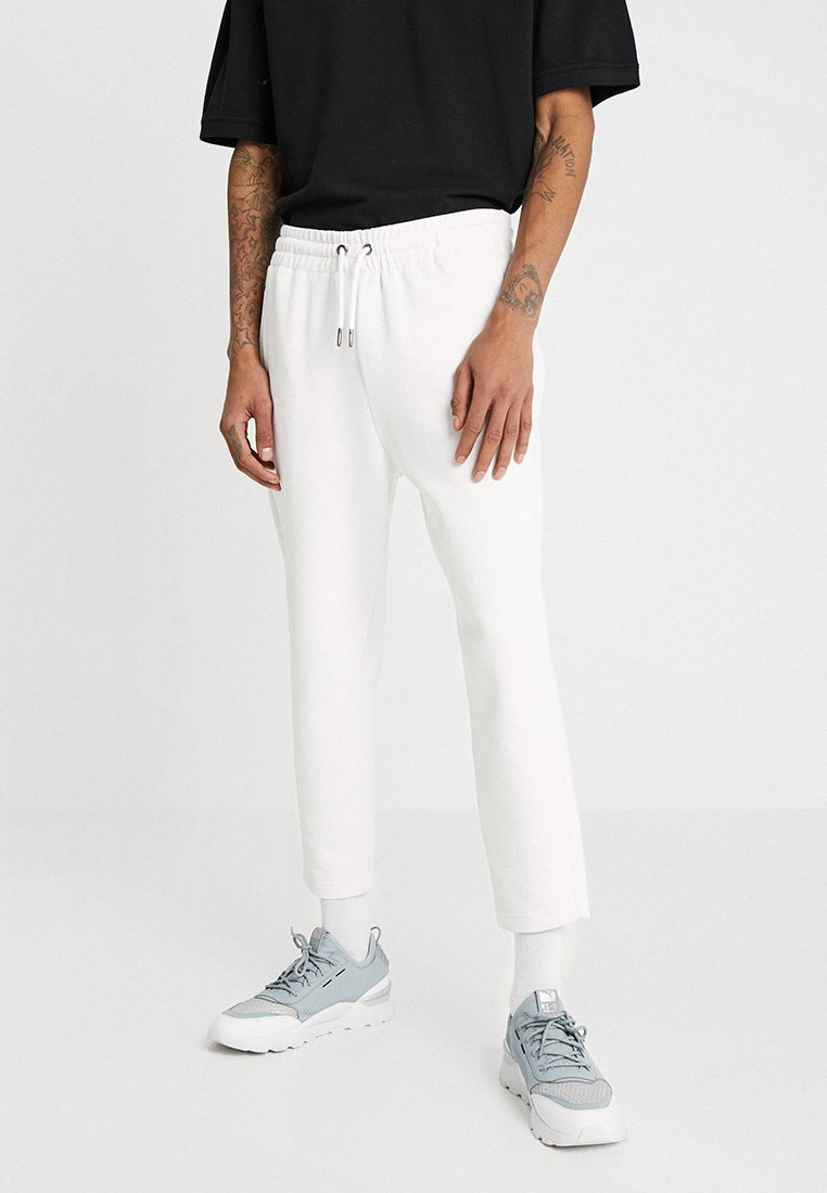Urban Classics - CROPPED HEAVY PANTS - Tracksuit bottoms - white