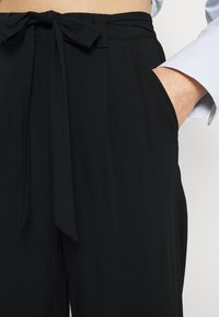 ONLY - ONLNOVA LIFE CROP PALAZZO PANT - Trousers - black - 5