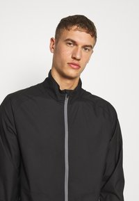 Puma Golf - ZEPHYR JACKET - Větrovka - black - 3
