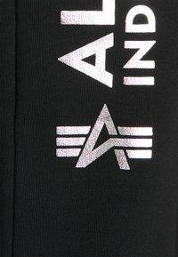 Alpha Industries - BASIC JOGGER FOIL PRINT - Träningsbyxor - black - 2
