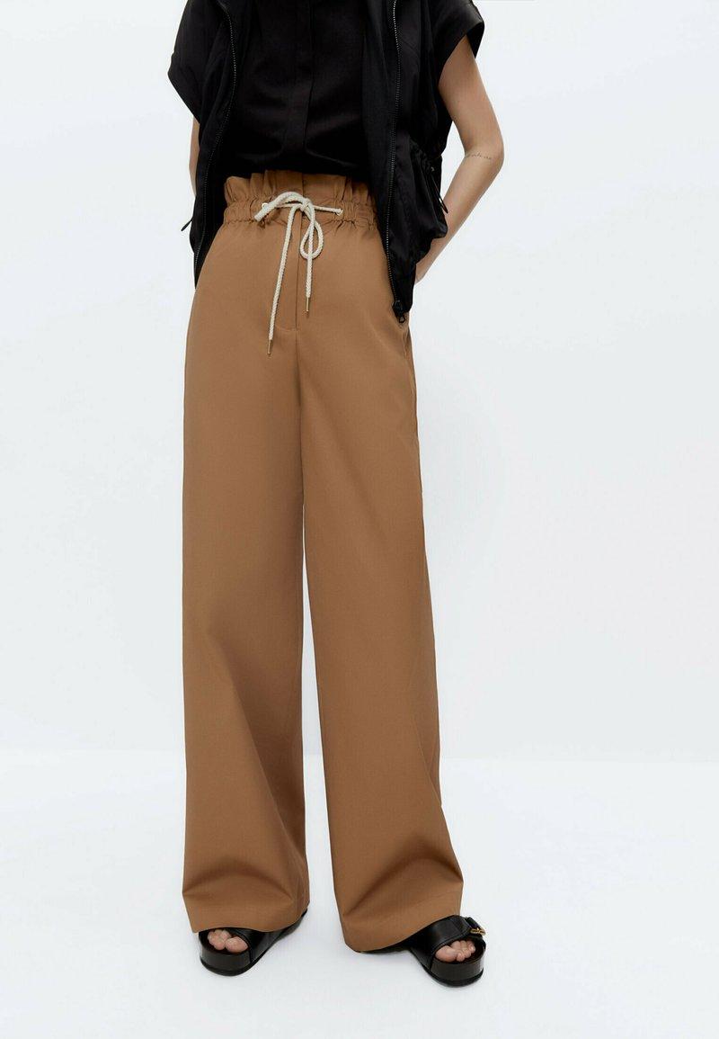 Uterqüe - Trousers - camel