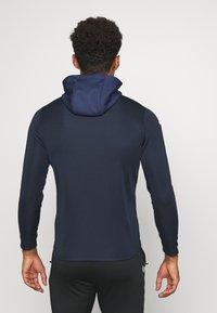 JAKO - CHAMP - Training jacket - marine/blue/neongelb - 2
