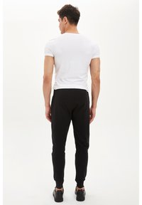 DeFacto - DEFACTO TRACKSUIT BOTTOMS - Spodnie treningowe - black - 2