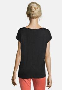 Cartoon - MUSTER - Print T-shirt - black/orange - 2