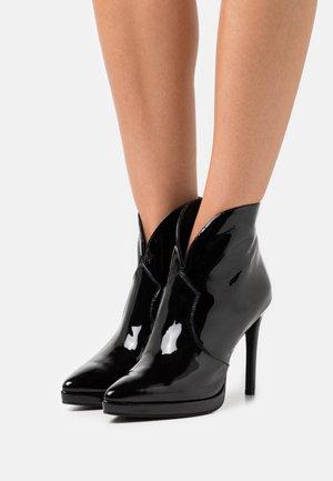 JOZA - Platform ankle boots - black