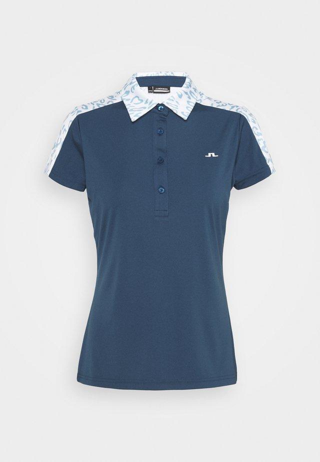 CARA GOLF - Polo - animal blue white