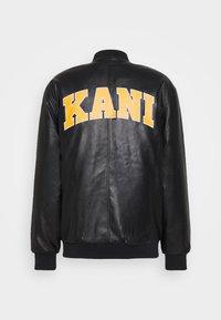 Karl Kani - OG COLLEGE JACKET UNISEX - Faux leather jacket - black/yellow - 1