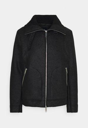 COAT SLIM FIT - Faux leather jacket - black