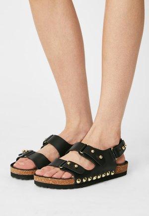 IZOE - Sandals - noir oro