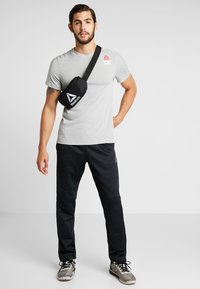 Reebok - WAISTBAG - Bum bag - black - 1