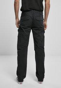 Brandit - ACCESSOIRES ADVEN  - Cargo trousers - black - 2