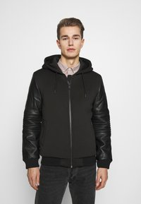 Guess - TECHNICAL HOODIE BOM - Faux leather jacket - jet black - 0