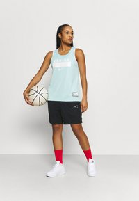 Nike Performance - FLY ESSENTIAL SHORT - Sports shorts - black - 1