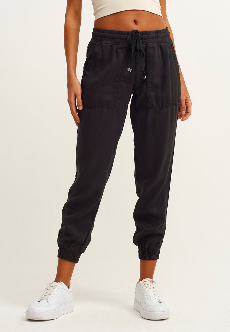 OXXO - Trousers - black