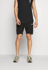 SQUATWOLF - WARRIOR SHORTS - Sports shorts - black - 0