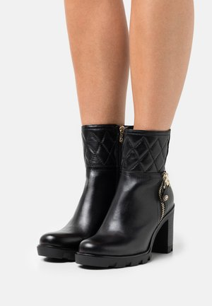 BY GUIDO MARIA KRETSCHMER - High heeled ankle boots - black/gold