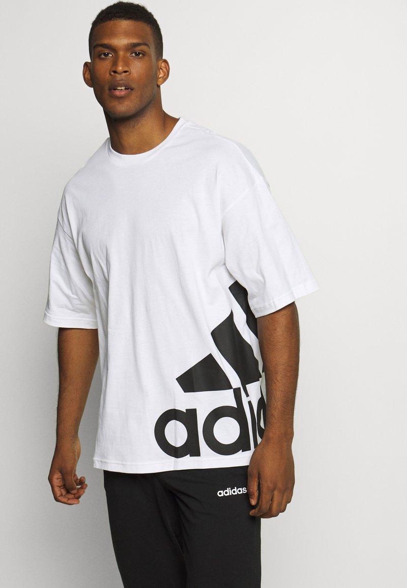 adidas Performance - BOXBOS TEE - T-shirt med print - white/black